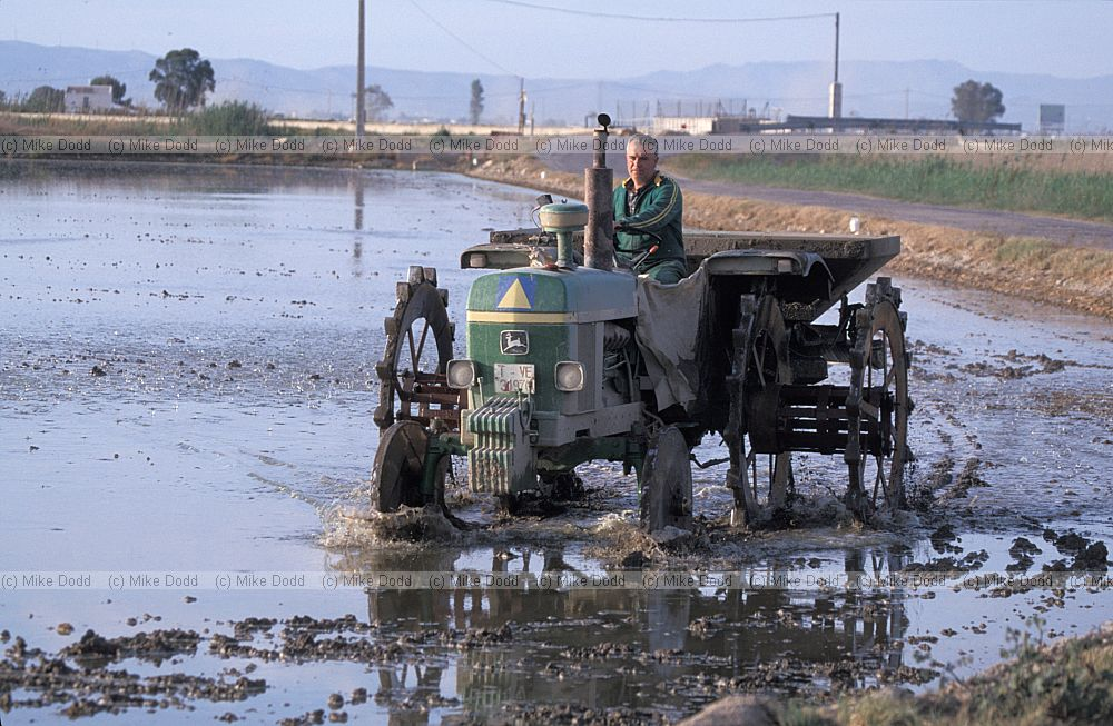 Tractor In Field Planting : Spain